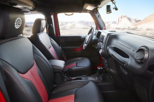 The Wrangler Red Rock Responder  interior stands out along with the exterior with embroidered black and red Mopar Katzkin leather seats, Jeep Performance Parts logo embroidered on the headrests, red accent bezels, grab handles and all-weather floor mats.